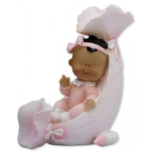A Porcelain Ethnic Baby Girl In A Shell
