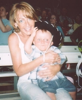 stephanie with youngest son at Texan rodeo